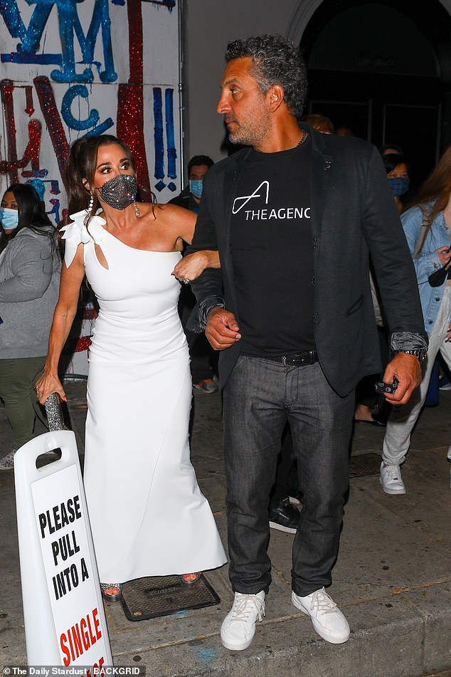 Wow:Slipping into an off-the-shoulder white gown teamed with a gemstone-encrusted facemask and matching clutch, the TV personality looked beautiful