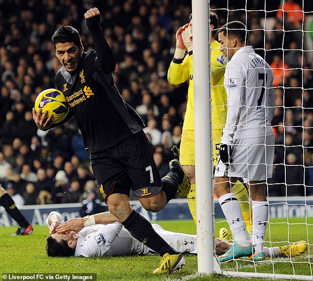 Spurs' Gareth Bale (on floor) was hit in the face whilst defending a corner against Liverpool