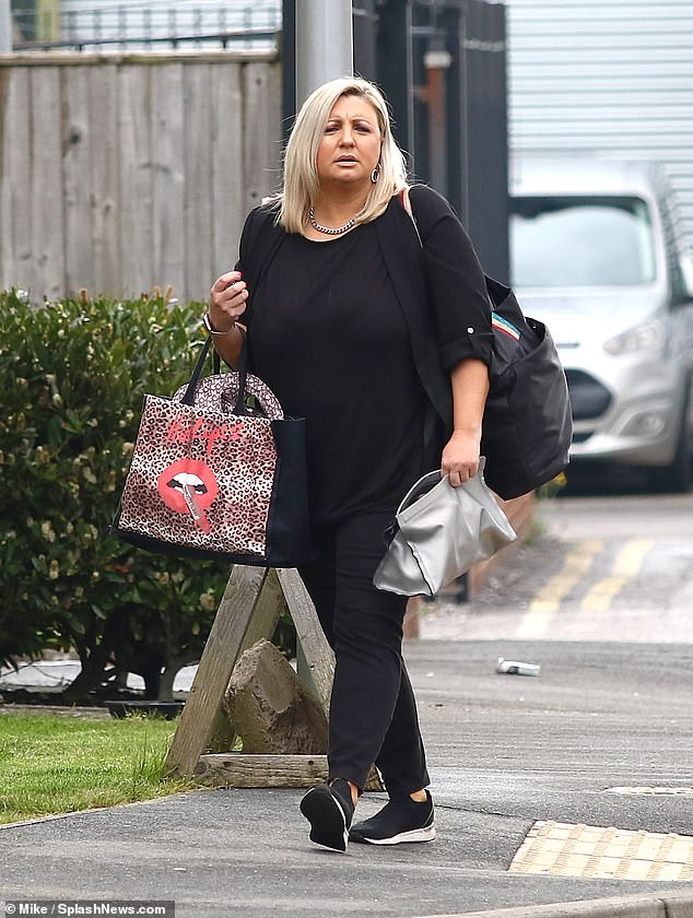 Stepping out:The Wales-born beauty carried her essentials in a leopard print shopping bag as she arrived for her day at work