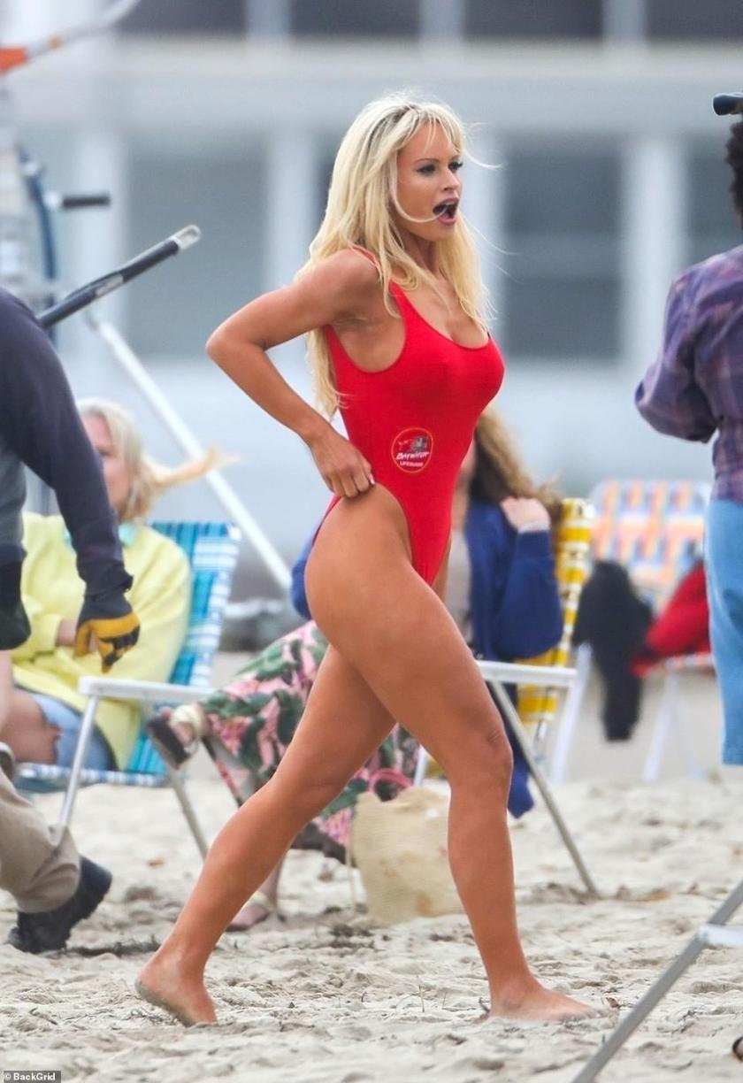 Simply stunning:The 32-year-old English actress certainly gave fans flashbacks of the 90's series as she wore the bright swimwear on the set of the Pam And Tommy series for Hulu