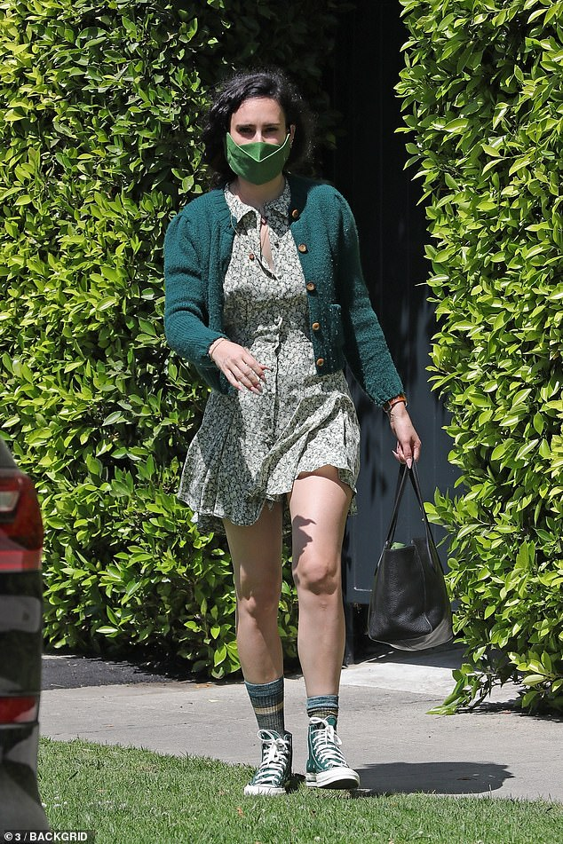 Seeing green: Rumer Willis opted to go above and beyond as she left her Pilates session. She was the picture of spring in a green floral dress and a green cardigan