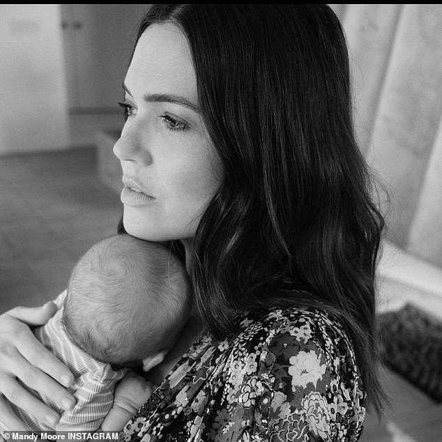 New addition: Moore welcomed her first child, son August Harrison Goldsmith, in February