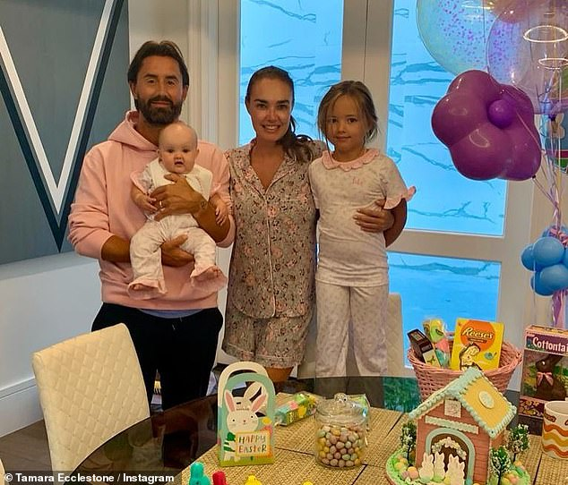 Happy family: Tamara and Jay alongside their daughters Sophia, seven, and new arrival Serena, eight months, have rented out swanky new digs in LA (the family pictured in the house)