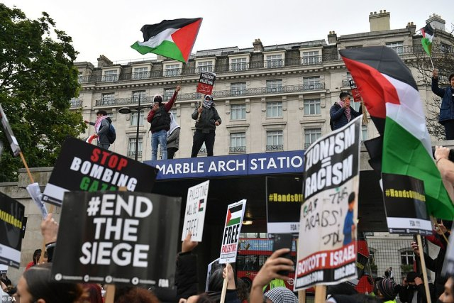 Demonstrators started gathering outside Marble Arch Station at midday for the march on Saturday