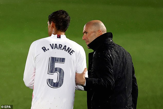 Varane may be sold by Zinedine Zidane's (right) side to raise money for summer signings