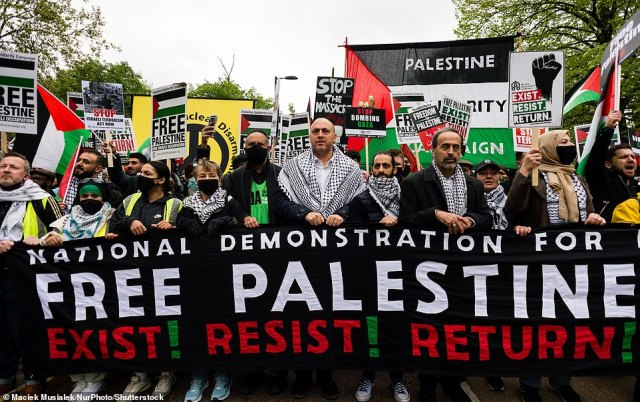 Thousands of people attend an emergency rally in solidarity with the Palestinian people in London