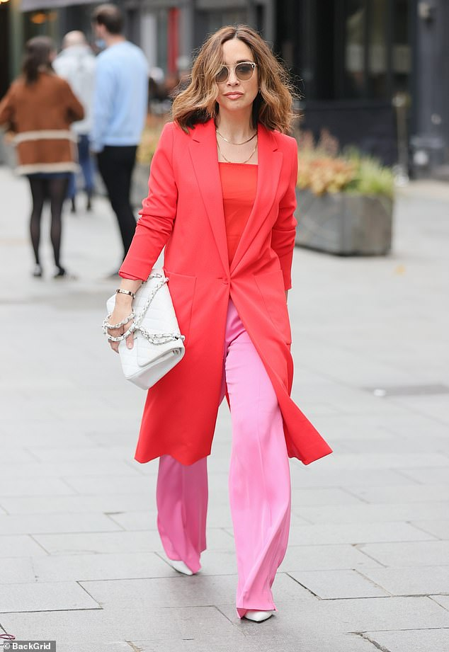 Trendsetter: Myleene Klass injected a pop of colour with her stunning red and pink outfit on Saturday as she arrived in style at Global Radio Studios in London