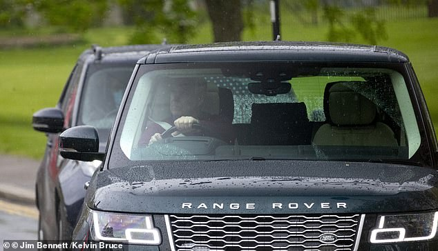The royal was later spotted driving away from the castle grounds in his personalised Range Rover