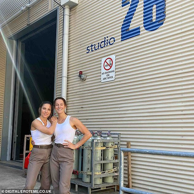 Looking good!The model shared this photo of herself posing alongside her stunt double outside the filming studio