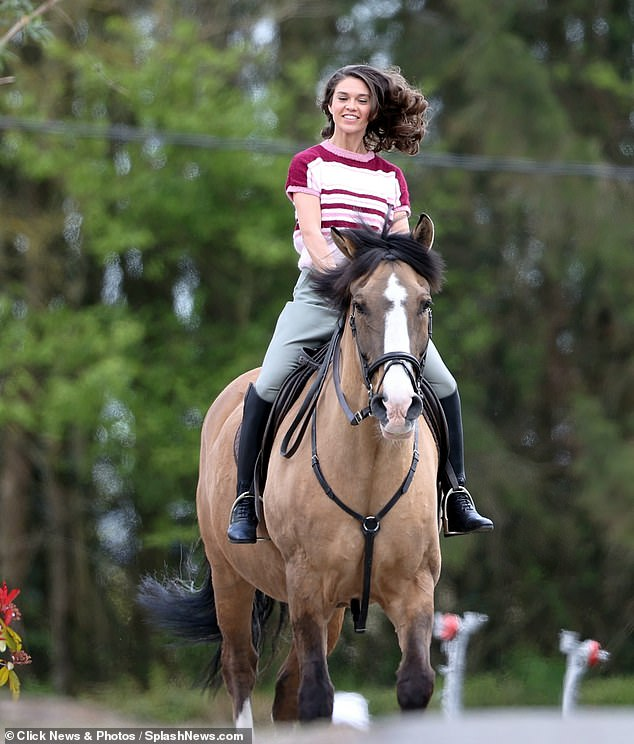 Gallop: The 29-year-old actress, who shot to fame through her role as Siena Rosso on hit Netflix show Bridgerton, looked glam as she galloped around the set on a horse