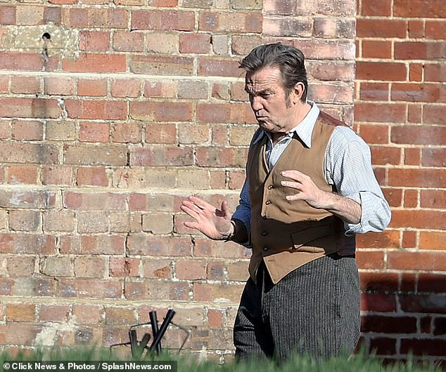 Getting into character: Ensuring he gave his best performance possible, the beloved TV star was seen rehearsing his lines in character in between takes