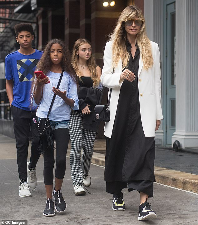 Moving on: Following her split from the singer, Klum began relationships with her bodyguard Martin Kirsten and art curator Vito Schnabel; she is pictured with three of her children in 2019