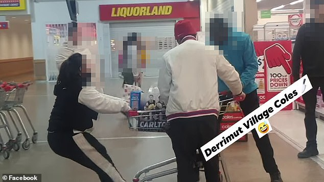 A Coles shopper has appeared to threaten a security guard with a weapon after she allegedly stole a trolley-load of groceries