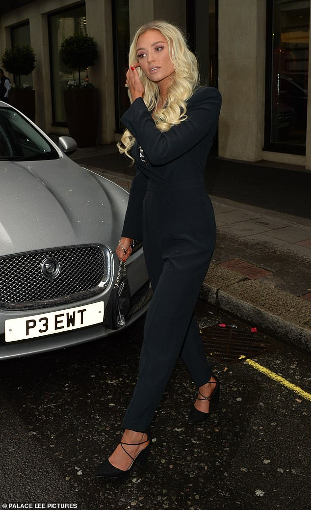 Glamor: Lucie, 23, also went for an all-black look, wearing a low-necked playsuit, which she teamed with strappy heels