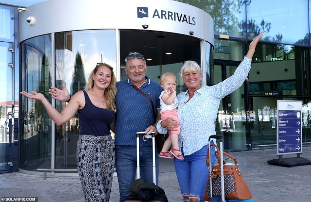 Grandparents David and Lynne Wilson meet her daughter Kelly Dolan and baby Gabriella at the airport in Gibraltar on the day global travel restrictions are eased