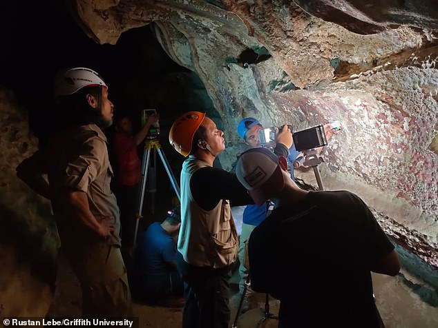 Researchers analyze rock art at Maros-Pangkep in Southern Indonesia. UnlikeFrance's famed Lascaux cave,Australasia has an incredibly volatile atmosphere, 'fed by intense sea currents, seasonal trade winds and a reservoir of warm ocean water, ' saysanthropologist Franco Viviani
