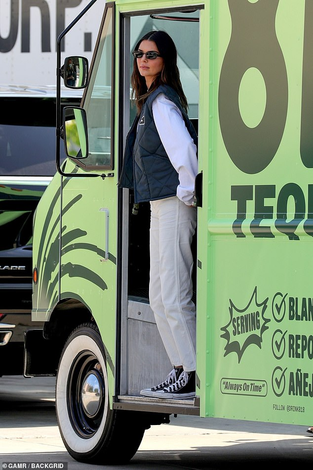 She's there!  Kendall wore a loose white long sleeve top with straight jeans and a navy 818 waistcoat with a 'Kenny' patch