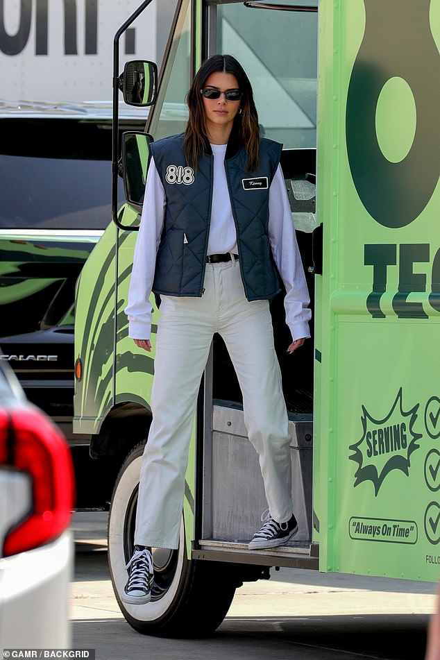 Outside: Kendall Jenner proved to be a practical boss as she greeted a large number of fans at the 818 tequila launch in Los Angeles on Monday afternoon.