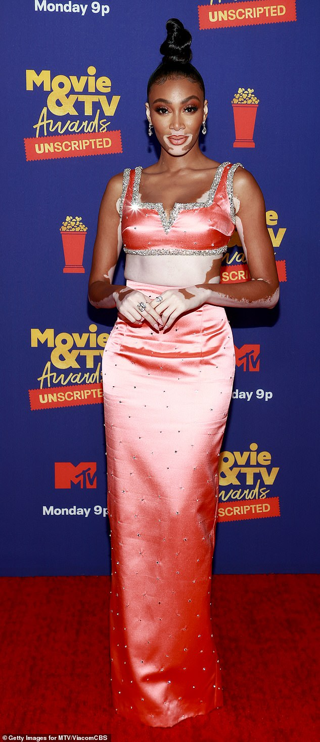 Eye-catching: Winnie Harlow made a striking red carpet appearance on the second night of the MTV Movie & TV Awards in Los Angeles which graced reality TV