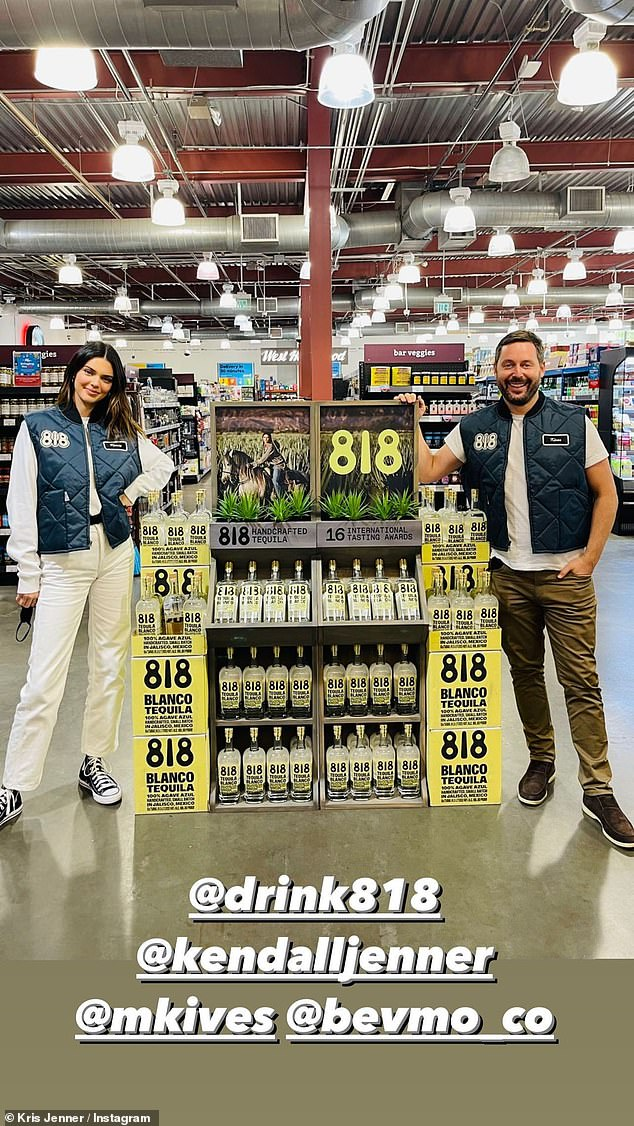 At work: The Keeping Up With the Kardashians star then took to BevMo where her bottles were proudly on display