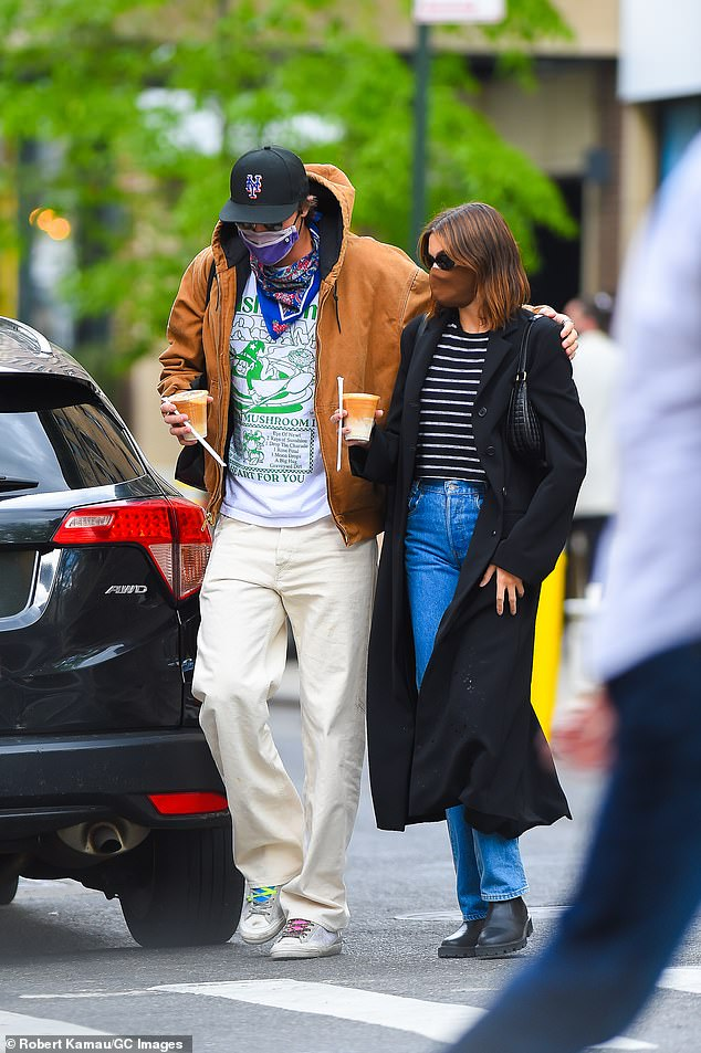 'It's actually crazy how much they have in common': The 23-year-old Australian (L, pictured last Tuesday) is the Los Angeles native's first public romance since ending her adventure in two months with SNL star Pete Davidson in December 2019