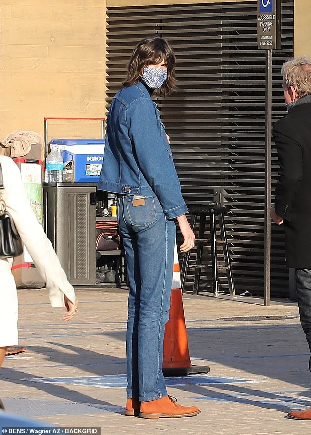 Style: Dylan, meanwhile, went for double denim, pairing a jacket with matching boot-cut pants and a black turtleneck top