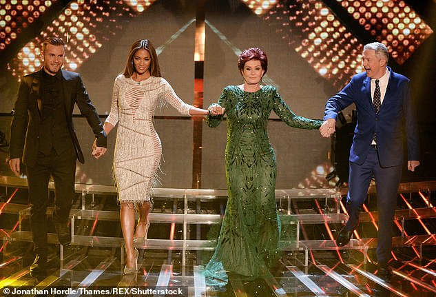 Missing: Take That's Gary Barlow (far left) took Simon's place in the 2013 series and starred with Louis Walsh, Sharon Osbourne and Nicole Scherzinger (pictured)