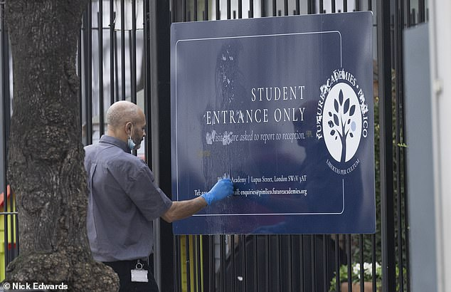 The sign outside the school, which was defaced with stickers during the protest, was cleaned up the next day