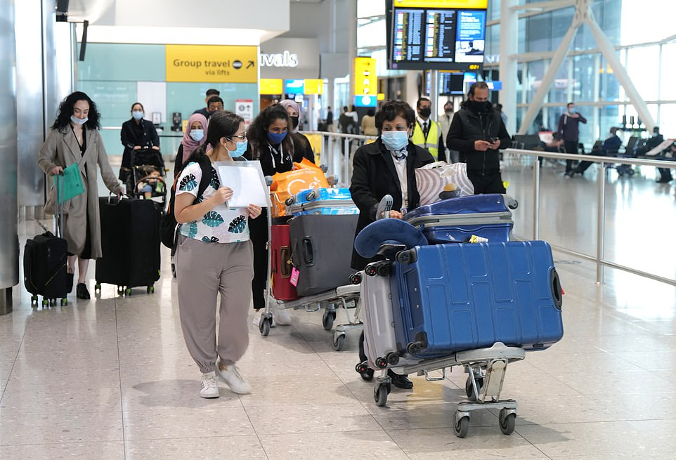 Passengers arrive at London Heathrow Terminal 2 yesterday, one day after the new travel 'traffic light' system came into force
