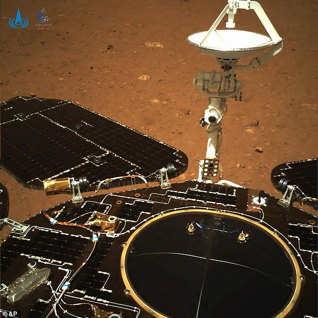 In this photo taken by China's Zhurong Mars rover and made available by the China National Space Administration (CNSA), a rear view of the rover shows solar panels and antenna are deployed as the rover sits on its lander on the surface of Mars