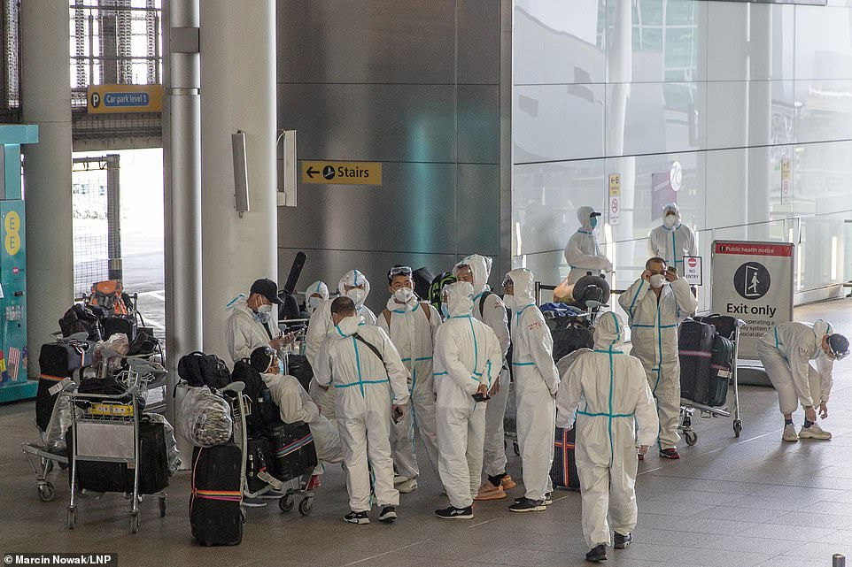 Heathrow Airport travellers arrive at the airport wearing full PPE suits as around five million British booked holidays to Europe