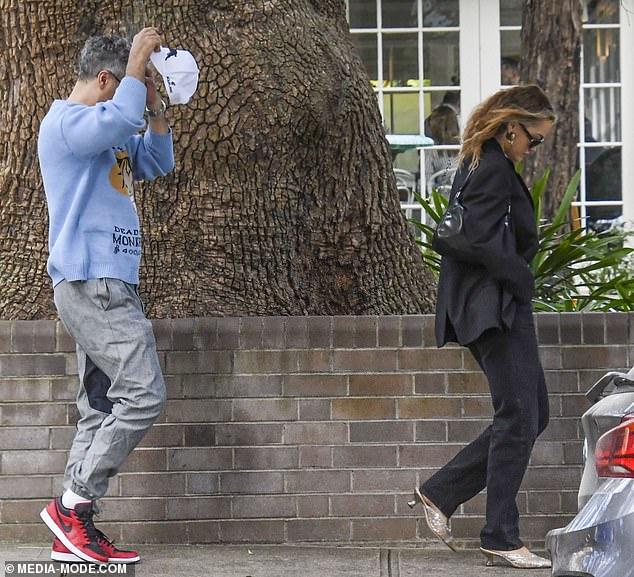 Footy fan: Taika wore a white NRL South Sydney Rabbitohs cap worn backwards