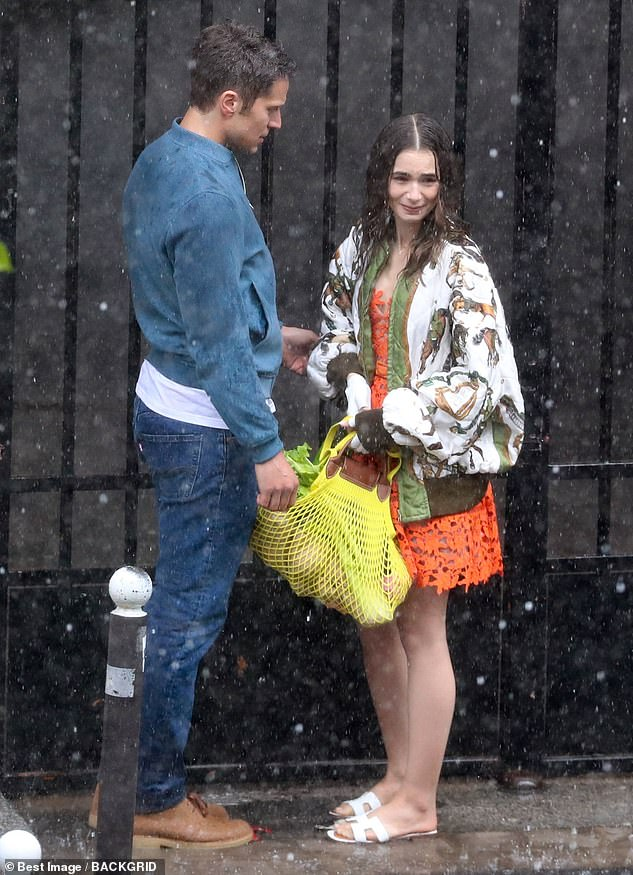 Will they, won't they?It is yet to be seen whether Emily and Gabriel embark in a romantic relationship in series two but the characters appeared to be shooting a cosy scene in the pouring rain