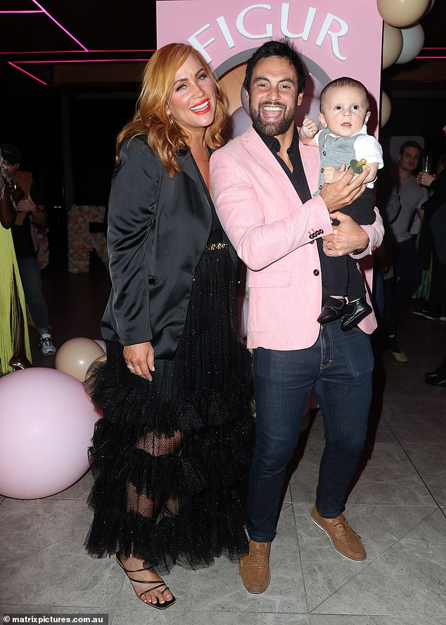 Family: Jules was supported by handsome husband Cameron Merchant along with their baby son, Oliver.Cam was all smiles with him wearing a pink blazer in support of his wife's new business venture