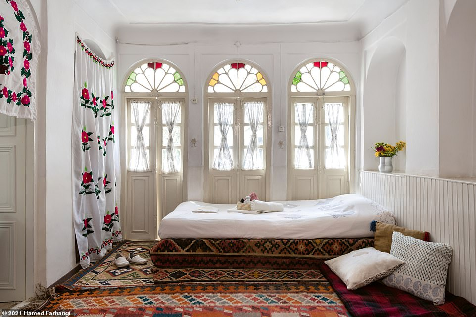 This photograph reveals how the rooms at Howzak House, near theUnesco-listed Masjed-e Jame mosque, in the city of Esfahan, look. According to Wegmann, the design of these rooms was inspired by Esfahan's nomination as the World City of Handicraft by the World Crafts Council in 2018. He writes: 'Each uniquely designed room is decorated with handicrafts collected from all over Iran as well as traditional Qalam-Kar (Persian woodblock printed textile) bed linens, curtains, and tablecloths