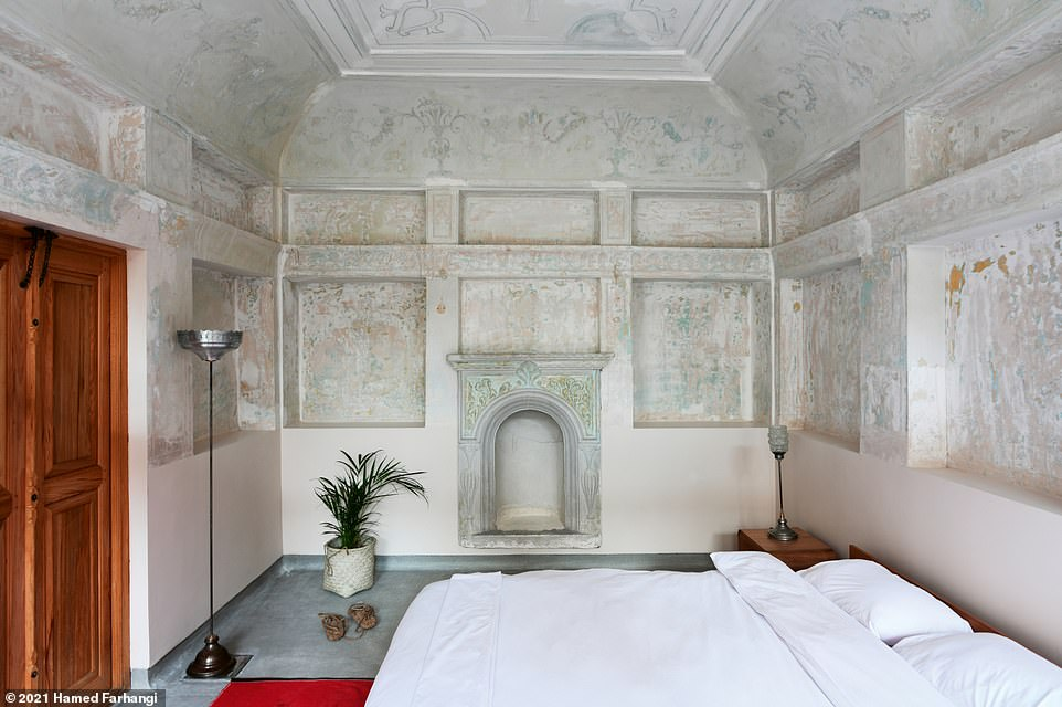 This snap showcases one of the seven guest rooms at the Joybar boutique hotel. Wegmannwrites: 'Purist interior design allows for rescued historic elements, like ceiling murals and fireplaces, to really stand out.' Shortly after guests wake up in this room, they can enjoy what Wegmann describes as a 'healthy Iranian breakfast of local and homemade dishes, and, upon order, a shot of espresso'