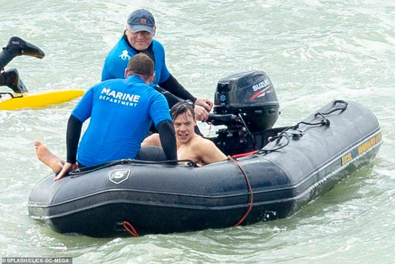 Slowly and surely: Harry was brought into the water by crew members on a speed boat as he prepared to film his latest part for the drama film