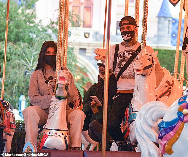 Kourtney Kardashian and Travis Barker blended their families together once again for a fun day at Disneyland in Anaheim, Calif. on Wednesday