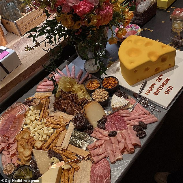 Making it happen:A sumptuous charcuterie display had been arranged for her alongside a huge block of cheese on a board that had a happy birthday message scrawled on it