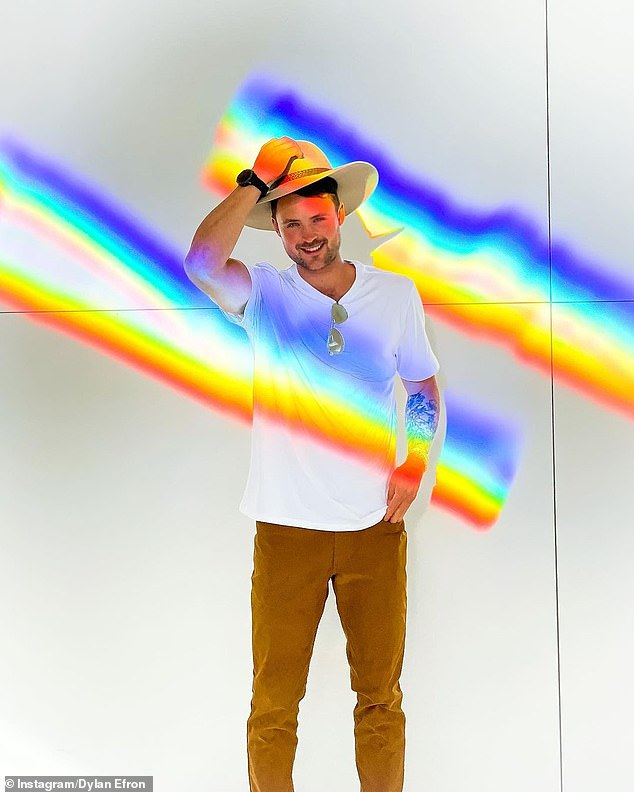 Cultured: Dylan, 29, also shared several photos on his Instagram account, showing himself posing next to a rainbow-themed artwork