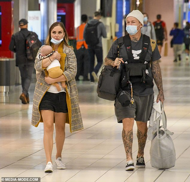 Relaxed: He showed off his array of tattoos in a pair of baggy grey shorts and a T-shirt