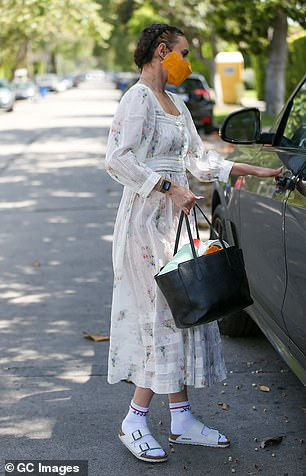 Comfy: She teamed her dress with socks and sandals
