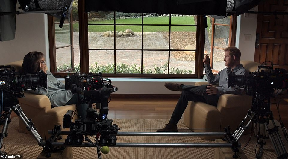 Royal fans were given a new insight into the upmarket $14million California home Prince Harry shares with Meghan Markle in his explosive new Apple TV series. In several scenes, Harry is seen speaking to the chat show host in front of a large window with dark timber frames and Georgian bars, offering a view of a courtyard garden area