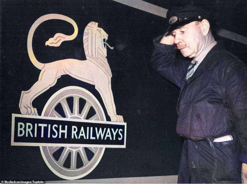 A train driver named G T Till examining the very first British Railways logo at Waterloo Station in London on February 15, 1949