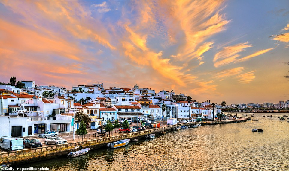 Enchanting: The village of Ferragudo on the Algarve. A recent Post Office report revealedthat the Algarve was the third cheapest place to visit for holidaying Britons