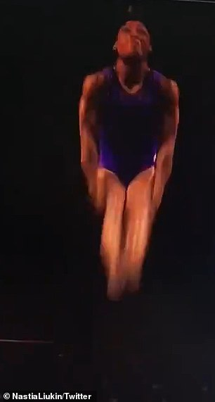 Up in the air: The vault - a Yurchenko double pike - requires Simone to flip her body around twice in the air, while in the pike position with her hips bent and her legs straight