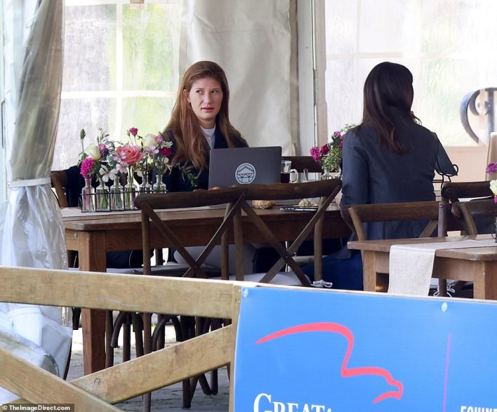Computing: Inside the tent, she used a dark laptop with a sticker for Evergate Stables, her international show jumping stable