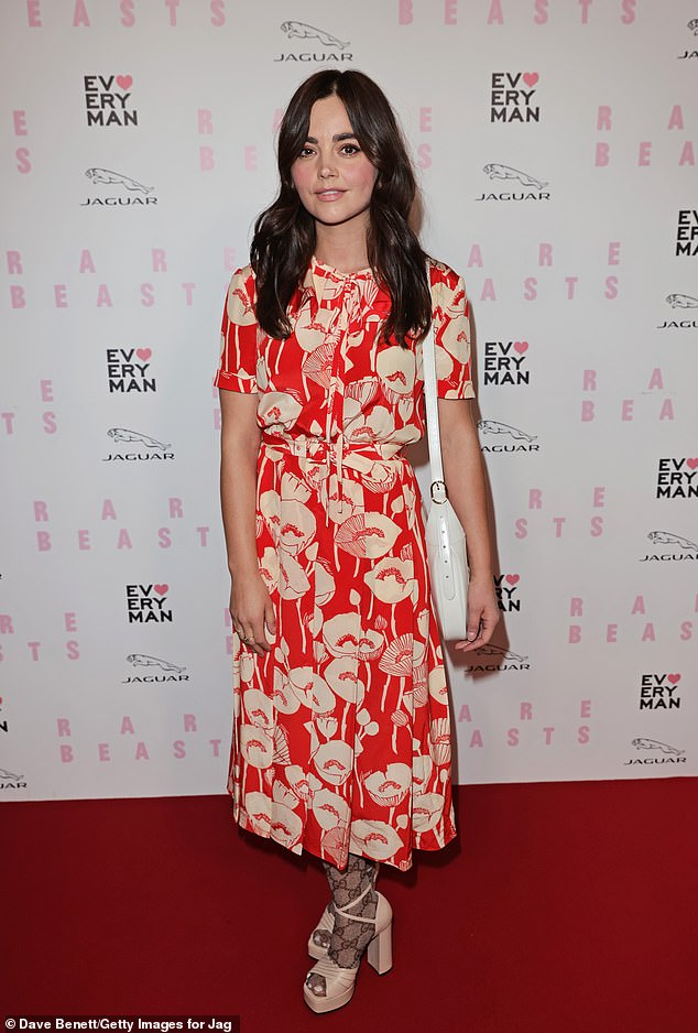 Blooming beautiful:Actress Jenna Coleman, 35, arrived at the red carpet extravaganza in a chic floral gown which she paired with Gucci tights and nude platform heels
