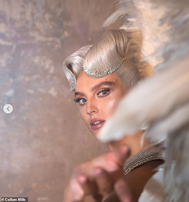 Beautiful: Another edgy image showed the singer sporting a striking hairstyle while wearing her huge white wings on set