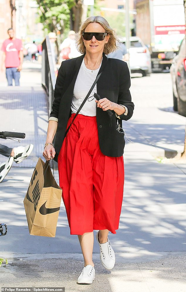 Stylish: Naomi Watts looked absolutely fantastic in a flowing red skirt after indulging in some light retail therapy at Nike with a friend and her rescue dog Izzy on Thursday